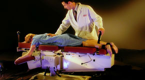 This is a picture of Cox Technic chiropratic spinal manipulation as performed at Dr. Le's Chiropractic & Wellness, L.L.C..